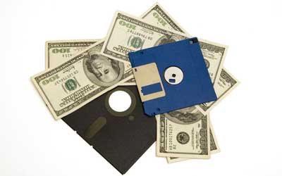 "multiple hundred dollar bills underneath 5 ¼"" floppy disk and 3 ½"" computer disk"