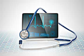 Stethoscope draped over computer screen