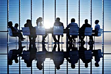 People sitting around large conference table