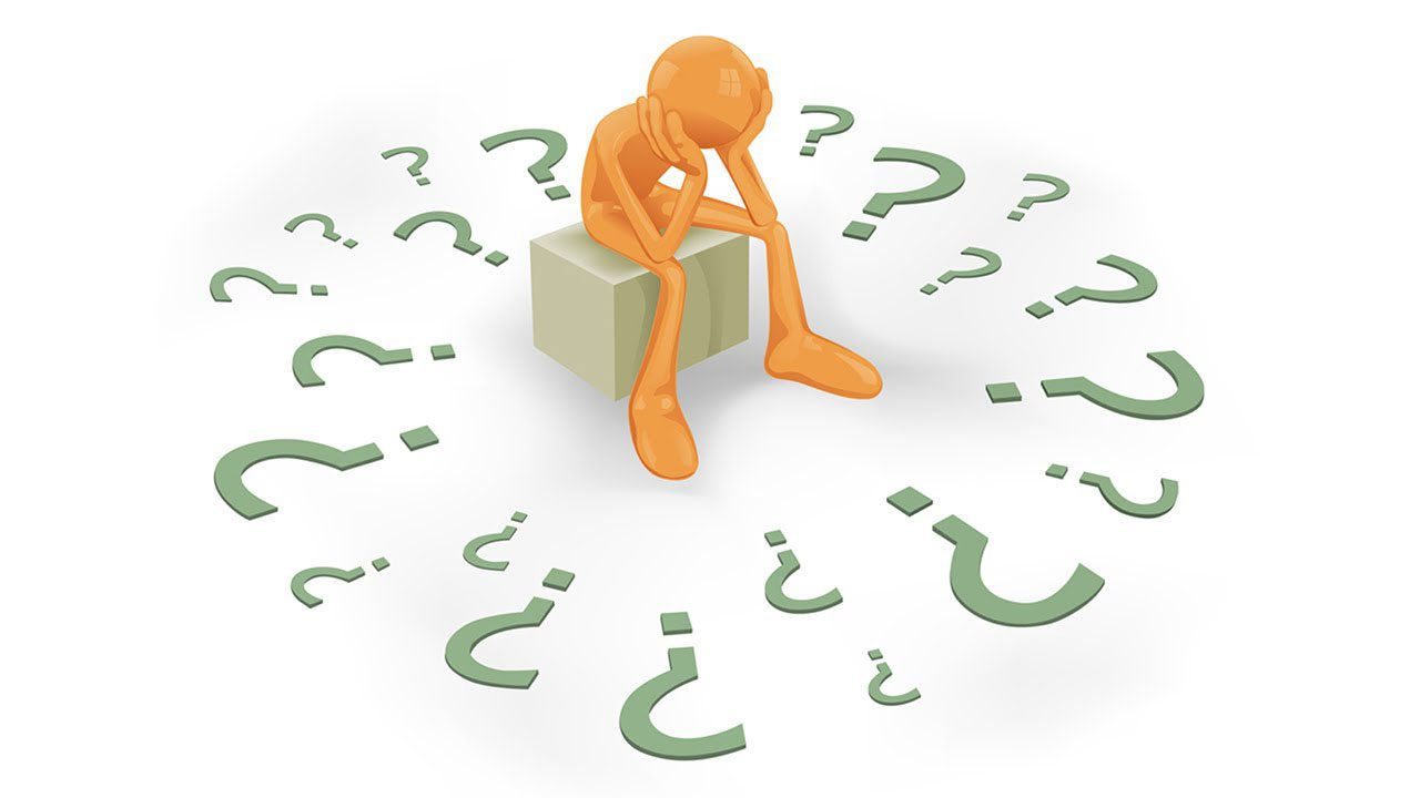 person surrounded by question marks