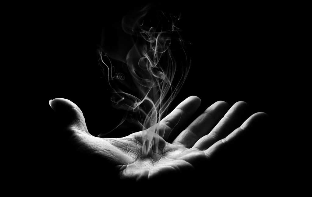 smoke rising from a hand