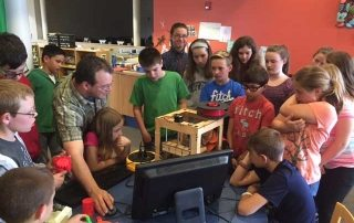 Jason Bittner demonstrating 3D printing to students