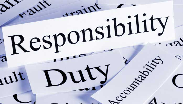"single words on individual paper spread out haphazardly - ""Accountability"", ""Duty"", ""Responsibility"" most prominently displayed"